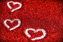 Red glitter hearts Valentine's Day abstract background love sparkle. Red glitter Valentine's Day theme abstract background love sparkle royalty free stock photos