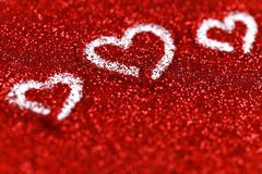 Red glitter hearts Valentine's Day abstract background love sparkle. Red glitter Valentine's Day theme abstract background love sparkle stock image