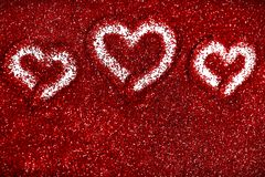 Red glitter hearts Valentine's Day abstract background love sparkle. Red glitter Valentine's Day theme abstract background love sparkle royalty free stock image