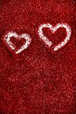 Red glitter hearts Valentine's Day abstract background love sparkle. Red glitter Valentine's Day theme abstract background love sparkle royalty free stock photography