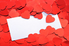Red glitter hearts. With white greeting card Stock Image