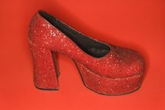 Red glitter high heel shoe. Red glitter high heel shoe against red background Stock Photos