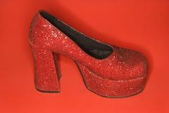 Red glitter high heel shoe. Stock Photos