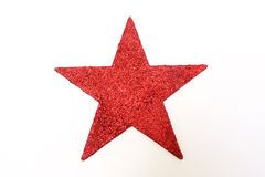 Red glitter star. A red glitter star isolated on white background Royalty Free Stock Photography