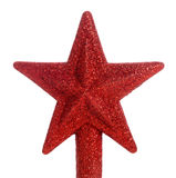 Red glitter star Christmas tree topper. A red glittered star Christmas tree topper royalty free stock image