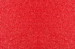 Red Glitter Texture. A Christmas texture background of red glitter, evenly spread from edge to edge of frame Stock Images