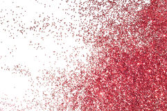 Red glitter texture on white background. S stock photography