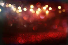 Red glitter vintage lights background. Red and black glitter vintage lights background. defocused Stock Photography
