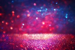 Red glitter vintage lights background. defocused. Red glitter vintage lights background. defocused Royalty Free Stock Images