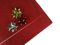 Red glittery Christmas paper and ribbons bows Stock Photo