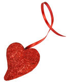 Red glittery heart on a ribbon. Red glittery heart and ribbon isolated on white background Royalty Free Stock Photo