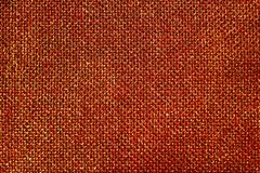 Red glittery jute background. The picture shows a red glittery jute background royalty free stock images