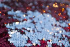 Silver glitter texture. Bokeh effect. Red glittery sequins background with blinking details royalty free stock images