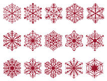 Red glittery textured snowflake designs isolated on white. A variety of shapes with glitter texture. Easy to isolate from background Royalty Free Stock Photo