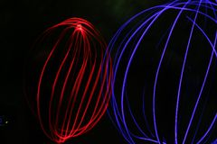 Red globe blue spherical electromagnetic emission Stock Image