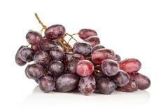 Fresh raw red wine grapes isolated on white. Red globe grape cluster isolated on white background dark pink berries Stock Photo
