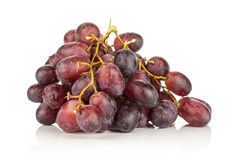 Fresh raw red wine grapes isolated on white. Red globe grape cluster isolated on white background fresh shiny deep pink berries Stock Photos