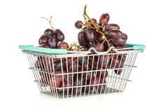 Fresh raw red wine grapes isolated on white. Red globe grape cluster in a shopping basket isolated on white background fresh shiny dark pink berries Stock Images