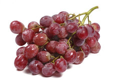 Red grapes bunch close up isolated white background Royalty Free Stock Photo