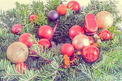 Red globe ornaments Christmas tree, pine branch close up Royalty Free Stock Photo