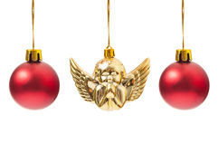 Red globes and one Christmas angel decoration. Hanging isolated on white background Royalty Free Stock Photo