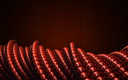 Red glossy balls as 3D geometry twisted circular shapes.  Royalty Free Stock Photography