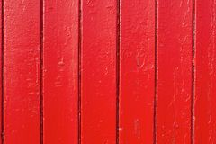 Red glossy paint planks vertical pattern background wood texture. Red wood vertical plank texture glossy paint background royalty free stock photography
