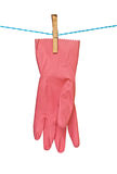 Red glove drying on rope Royalty Free Stock Photos