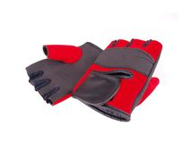 Red Gloves. A pair of Red exercise gloves isolated stock image