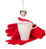 Red gloves and brewing  tea Stock Images