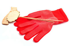 Red gloves for the garden with wooden plates separate Royalty Free Stock Photos