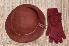 Red gloves and hat. On a large knitting yarn Royalty Free Stock Photography