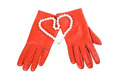 Red gloves and heart (isolated) Stock Photos