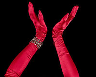 Red Gloves thrown up Stock Photo