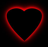 Red glow heart over black Stock Photography