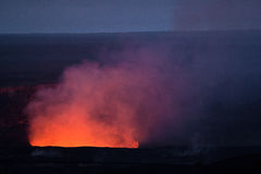 Red glow from lava lake Stock Photo