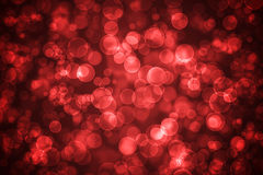 Red glowing bokeh holiday background Stock Photos