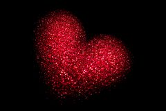 Red glowing heart on a black background. Happy Valentine`s Day.  stock photo