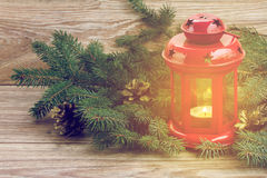 Red glowing  lantern with evergreen tree Stock Photo
