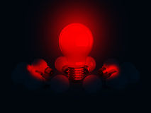 Red Glowing Light Bulb on Dark Stock Photos