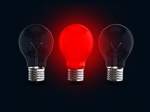 Red Glowing Light Bulb Among Two Royalty Free Stock Photography