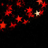 Red glowing star background with copy space. Illustration of al background with red stars and bokeh - blur effect royalty free illustration