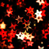 Red glowing star background. Illustration of a background with illuminated stars and bokeh - blur effect stock illustration