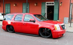 Red GMC Yukon with Custom Lowered Springs Royalty Free Stock Photography