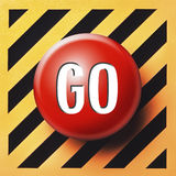 Red GO button. On yellow and black panel Stock Images