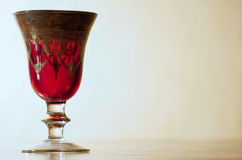 Red goblet. S in transparency on a table Royalty Free Stock Image