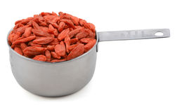 Red goji berries in a cup measure Stock Photos
