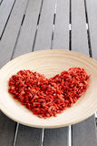Red Goji's Berries. A plate full of red Goji's Berries, the fruit of the wellness Stock Photo
