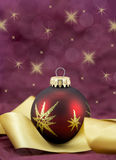Red and Gold  Bauble. Red and gold christmas bauble with a gold ribbon Stock Photos