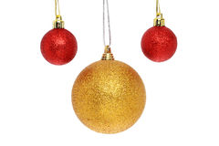 Red and gold baubles. Red and gold Christmas baubles isolated against white Royalty Free Stock Image